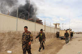 Smoke rises from a building, where Taliban insurgents hide during a firefight with Afghan security forces, in Helmand province, southwest Afghanistan, March 9, 2016.