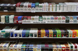 FILE - Cigarette packs are displayed at a smoke shop in New York.