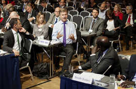 A delegate at the South Sudan donor conference in Oslo, Norway, addresses South Sudan Foreign Minister Barnaba Marial Benjamin.