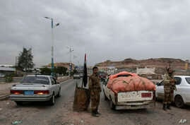 Yemeni soldiers inspect cars at a checkpoin leading to the U.S. embassy in Sanaa, Yemen, Aug. 4, 2013, one of 21 U.S. diplomatic missions Washington ordered closed for the weekend due to threat of an al-Qaida attack.