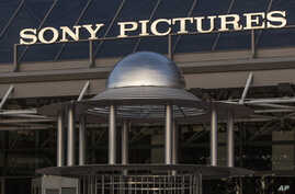 "FILE - Hacker attacks related to the Sony Pictures film ""The Interview"" and disruption of the company's PlayStation gaming network have fueled companies' concerns about cybersecurity."