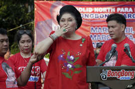 FILE - Former Philippine First Lady Imelda Marcos blows kisses to supporters. The Philippine government will launch a website to crowd-source tips on the whereabouts of some 200 missing art works formerly owned by Marcos.