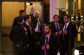 """Vice President-elect Mike Pence (top center) leaves the Richard Rodgers Theatre after a performance of """"Hamilton"""" in New York, Nov. 18, 2016."""