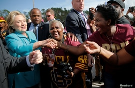 U.S. Democratic presidential nominee Hillary Clinton greets tailgaters at the Bethune-Cookman University Wildcats homecoming football game in Daytona Beach, Fla., Oct.  29, 2016.