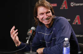 Former major league pitcher Randy Johnson speaks with reporters in Phoenix after being selected to enter the National Baseball Hall of Fame, Jan. 6, 2015.