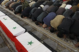Syrians Mourn 26 Killed in Damascus Bombing