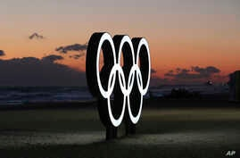 Olympic rings are placed at the beach before sunrise in Gangneung, South Korea, Jan. 24, 2018. Gangneung is the site of the coastal cluster which will host ice hockey, figure skating, speedskating, short track and curling for the 2018 Olympics from