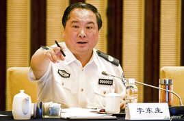 FILE - Then vice minister of public security Li Dongsheng gestures as he speaks during a meeting in Nanjing, Jiangsu province.