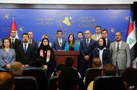 Iraqi Kurdish lawmakers, members of Kurdistan Democratic Party Parliamentary block speaks to journalists during a press conference in Baghdad, Iraq, Oct. 2, 2018.