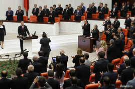 Turkey's new President Tayyip Erdogan attends a swearing in ceremony at the parliament in Ankara, Turkey, Aug. 28, 2014.