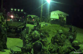 An undated handout photograph released by Kenya's Ministry of Defense on September 29, 2012, shows members of the Kenyan Defense Forces during an operation at an undisclosed location in Somalia.