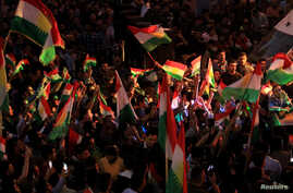 Kurds celebrate in support of the independence referendum in Duhok, Iraq, Sept. 26, 2017.