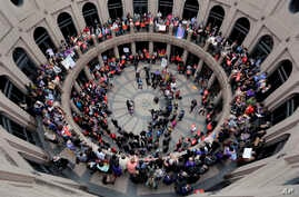 Members of the transgender community and others who oppose Senate Bill 6 protest in the exterior rotunda at the Texas state Capitol as the Senate State Affairs Committee holds hearings on the bill, March 7, 2017, in Austin, Texas.