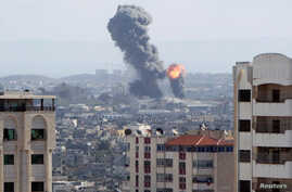 An explosion is seen during Israeli air strikes in Gaza, Oct. 27, 2018.