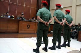 Indonesian special forces soldiers listen as judges deliver their sentence at a military court in Yogyakarta, Indonesia, Sept. 5, 2013.