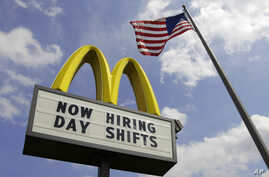This May 2, 2012, file photo shows a sign advertising job openings outside a McDonald's restaurant in Chesterland, Ohio.