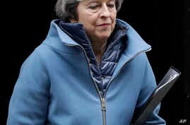 Britain's Prime Minister Theresa May leaves 10 Downing Street in London, Feb. 12, 2019.