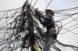 An official of Nigeria Power works on power lines in Lagos, Nigeria, July 22, 2011.