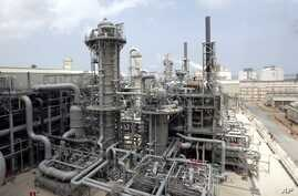 FILE - A gas production facility is seen in at Ras Laffan, Qatar, April 4, 2009.  .
