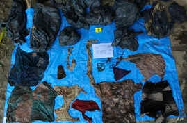 In this undated photo provided by the Veracruz State Prosecutor's Office shows clothing items found at the site of a clandestine burial pit in the Gulf coast state of Veracruz, Mexico, Sept. 6, 2018.