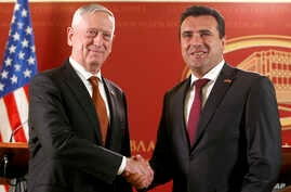 U.S. Defense Secretary James Mattis, left, shakes hands with Macedonian Prime Minister Zoran Zaev, right, during their meeting at the government building in Skopje, Macedonia, Sept. 17, 2018. Zaev met with Vice President Mike Pence in Washington, Sep