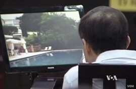 Video from the trial of a Chinese official accused of corruption.