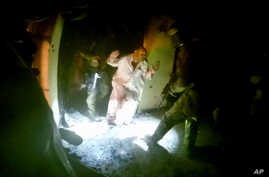 Image from helmet-mounted video camera shows U.S., Iraqi special forces freeing hostages from IS-controlled prison controlled in Huwija, 15 kilometers west of Kirkuk, Oct. 22, 2015.