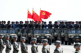 Soldiers of China's People's Liberation Army (PLA) march during a military parade to commemorate the 90th anniversary of the foundation of the army at the Zhurihe military training base in Inner Mongolia Autonomous Region, China, July 30, 2017.