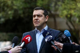 Greece's Prime Minister Alexis Tsipras makes a statement following the resignation of Defense Minister Panos Kammenos, in Athens, Jan. 13, 2019.