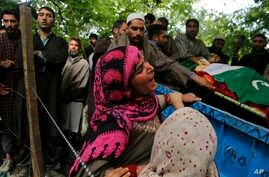 A relative cries during the funeral of civilian Adil Magray at Shopian, about 60 kilometers (38 miles) south of Srinagar, Indian controlled Kashmir, June 7, 2017.