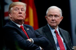 FILE - President Donald Trump sits with Attorney General Jeff Sessions during the FBI National Academy graduation ceremony in Quantico, Va., Dec. 15, 2017. Trump's White House counsel personally lobbied Attorney General Jeff Sessions to not recuse hi