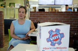FILE - Christina Hernandez, an official with Organize Now, spends time at the Valisa Bakery to register voters in Orlando, Fla., Oct. 4, 2016. Organize Now is a progressive, grassroots nonprofit that is part of a coalition of groups working on regist