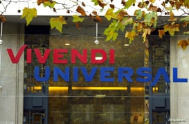 FILE - The logo of Vivendi Universal is seen on top on the main entrance at the company's headquarters in Paris, Nov. 17, 2003.