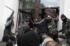 Pro-Russia activists storm the regional government headquarters in Luhansk, eastern Ukraine, April 29, 2014.