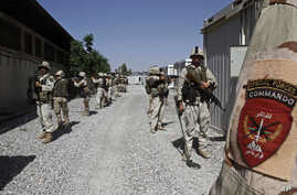 FILE - Afghan special forces demonstrate their skills at a training center in Kandahar, south of Kabul, Afghanistan, May 4, 2014.