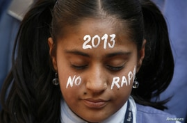 A student prays during a vigil for a gang rape victim, who was assaulted in New Delhi, in Ahmedabad, India, December 31, 2012.