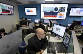 FILE - Microsoft control technician Ray Nichols monitors energy usage in real time at Microsoft Corp.'s operations center in Redmond, Wash.