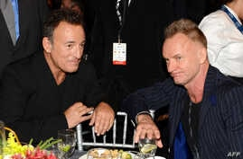 FILE - Honoree Bruce Springstein (R) and singer Sting attend MusiCares Person Of The Year Honoring Springsteen at Los Angeles Convention Center on Feb. 8, 2013 in California.