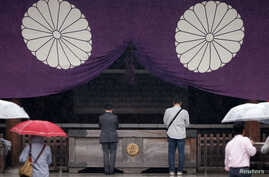 Visitors pray at the Yasukuni Shrine in Tokyo, Japan, Oct. 17, 2016.