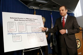 Preet Bharara, U.S. Attorney for the Southern District of New York, announces a settlement with JPMorgan Chase, Jan. 7, 2014 in New York.