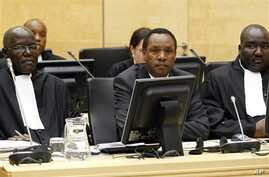 Former Kenyan Minister of Industrialization Henry Kiprono Kosgey, center, sits in the courtroom of the International Criminal Court (ICC) in The Hague, Netherlands, Sept. 1, 2011