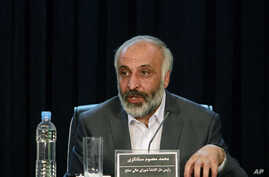 Masoom Stanekzai secretary of a peace council set up by Afghan President Hamid Karzai, speaks during a press conference with Afghan Deputy Foreign Minister Jawid Luddin and Afghan presidential spokesman Waheed Omar unseen, in Kabul, Afghanistan Sunda