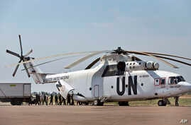 FILE - A United Nations helicopter offloads supplies at the airport in Malakal, South Sudan.