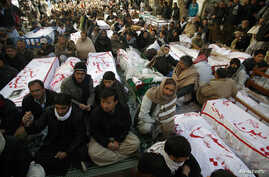 Shi'ite Muslims display the unburied coffins of victims of Thursday's twin bomb attack during a sit-in in Quetta, January 12, 2013.