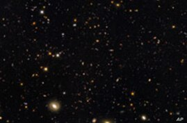 More than 12 billion years of cosmic history are shown in this unprecedented, panoramic, full-color view of thousands of galaxies in various stages of assembly