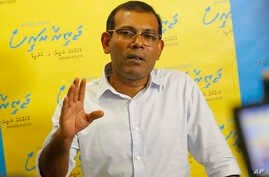 FILE - Former Maldives President Mohamed Nasheed interacts with supporters in the Maldives through a Skype call from his residence in Colombo, Sri Lanka,  May 31, 2018. The exiled former president says he has abandoned plans to contest an upcoming pr
