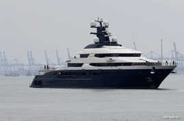 Seized luxury yacht Equanimity, belonging to fugitive Malaysian financier Low Taek Jho, is brought to Boustead Cruise Terminal in Port Klang, Malaysia, Aug. 7, 2018.