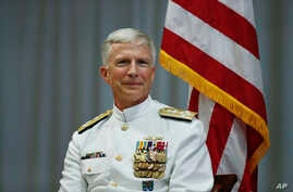 U.S. Navy Adm. Craig Faller sits on stage during a change of command ceremony at the U.S. Southern Command headquarters, Nov. 26, 2018, in Doral, Fla. The ceremony appointed Navy Adm. Craig Faller as new leader of the command that oversees U.S. milit