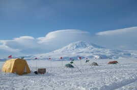 1.Base camp on the McMurdo Ice Shelf floats on a 200-meter- thick ice shelf, which in turn floats on the ocean which is one kilometer deep at that point.  Credit: David Holland