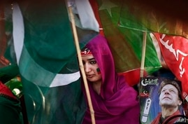 Pakistani supporter of former cricket star-turned-politician, Imran Khan, takes part in rally, Islamabad, May 9, 2013.